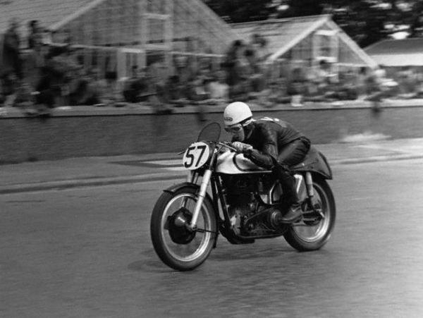 Geoff Duke Races on his Motorcycle